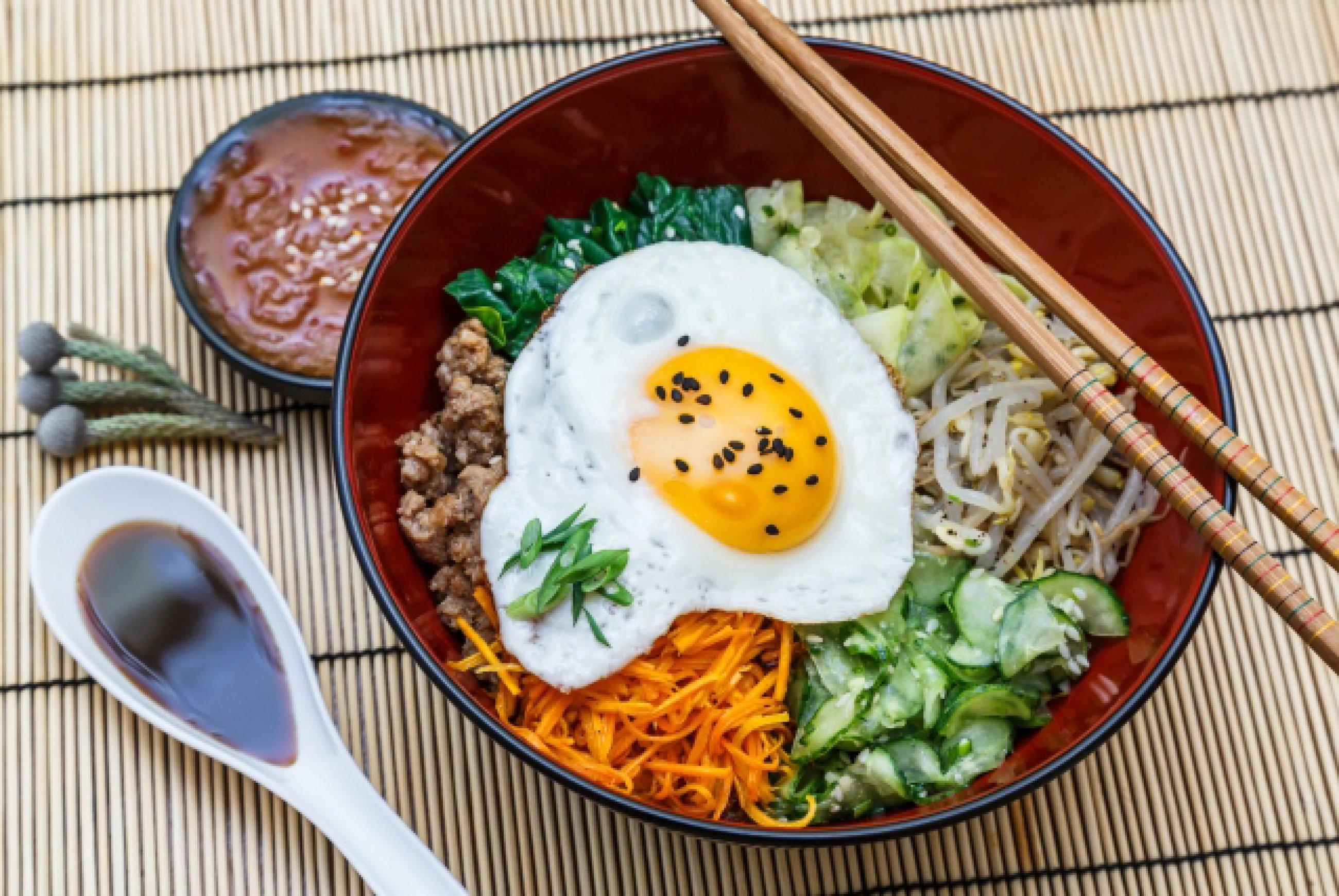 https://bubo.sk/uploads/galleries/7452/bibimbap-in-a-bowl-korean-dish-on-bamboo-mat.jpg
